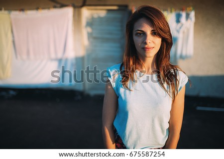 Portrait of young beautiful brunette standing girl #675587254