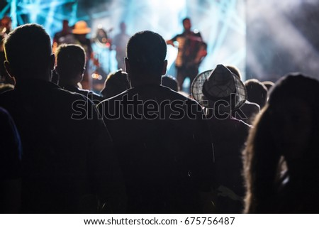 Photo of many people enjoying rock concert, audience applauding to musician band, night entertainment, music festival, happy youth, luxury party #675756487