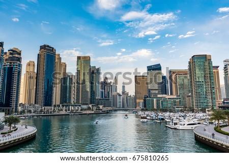 Dubai, United Arab Emirates - February 9, 2017 - Panoramic view of the Dubai marina on a beautiful day #675810265