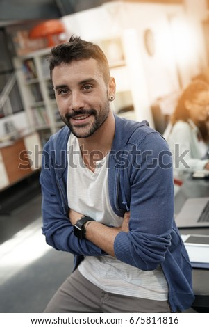 Trendy guy in coworking office with arms crossed #675814816