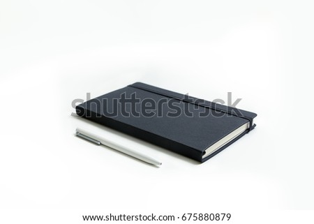 Notebook and white pen isolated on white background #675880879