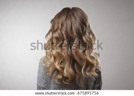 Demonstration of hairstyles long curls on the blonde woman on isolated background #675895756