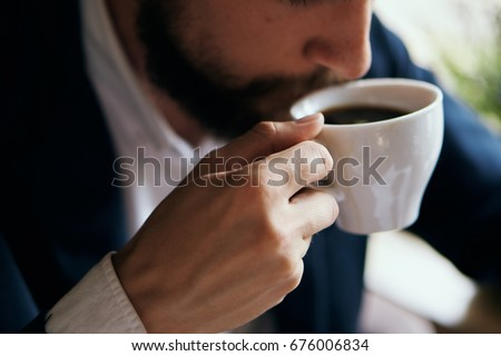 Business man drinking coffee in a cafe                                #676006834