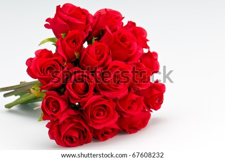 Bouquet of artificial red roses, isolated, space for copy in the side. #67608232