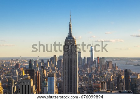 New York City, United States - May 15, 2017: Empire State Building and skyscrapers at sunset. #676099894