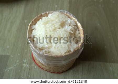 Sticky rice in a container plaiting The cuisine of Northeastern Thailand. #676121848