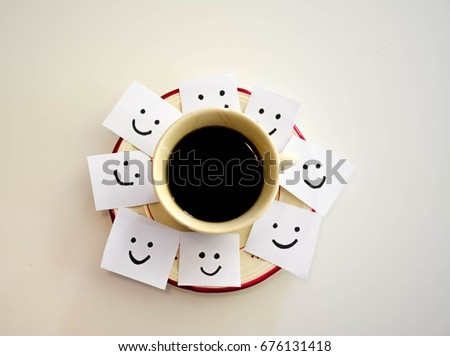 Cup of coffee and smiley faces on a white notes #676131418