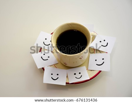 Cup of coffee and smiley faces on a white notes #676131436