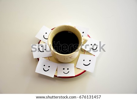 Cup of coffee and smiley faces on a white notes #676131457