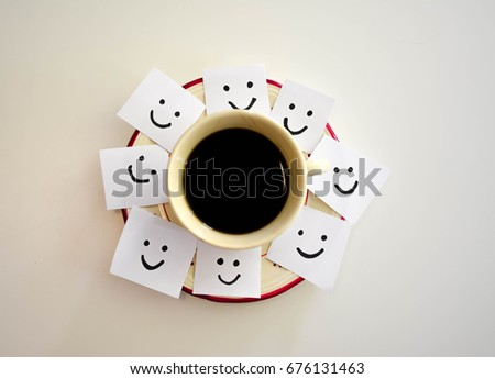 Cup of coffee and smiley faces on a white notes #676131463