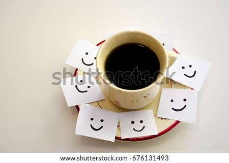 Cup of coffee and smiley faces on a white notes #676131493