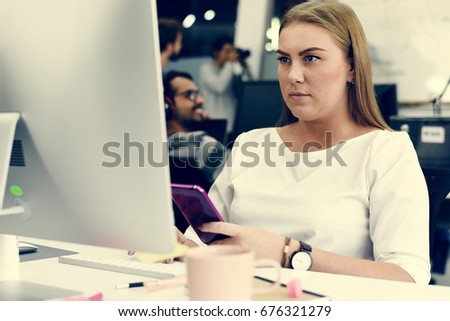 Woman working with computer at the office #676321279