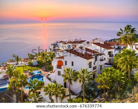 Sunrise in Puerto de Santiago city,  Atlantic Ocean coast, Tenerife, Canary island, Spain Royalty-Free Stock Photo #676339774