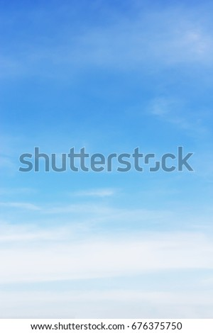 Soft white clouds against blue sky background and empty space for your design. #676375750