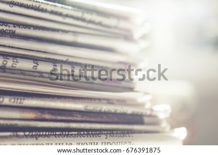 Newspapers close up background  Royalty-Free Stock Photo #676391875