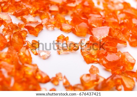 Orange Citrine gemstones on white background. Bright backdrop of natural jewels with free space for text, close up. #676437421