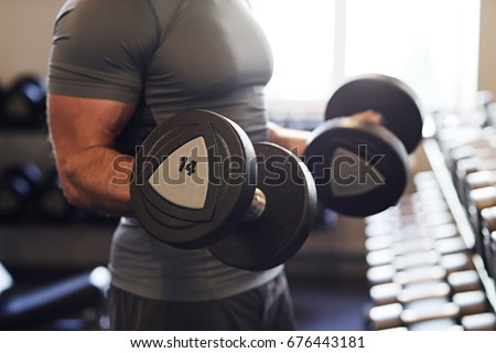 Fitness. Man in the gym #676443181