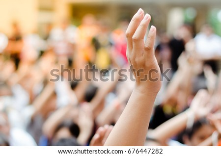 Raising Hands for Participation. Royalty-Free Stock Photo #676447282