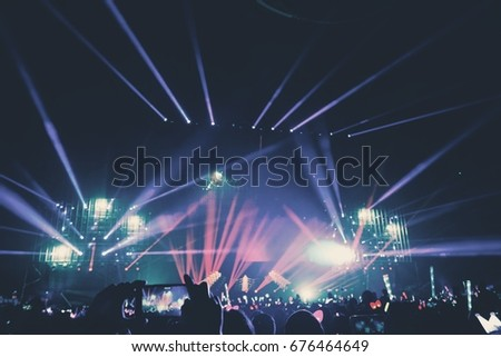 Defocused entertainment concert lighting on stage, blurred disco party. Royalty-Free Stock Photo #676464649