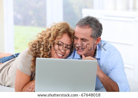 Couple surfing on internet at home #67648018