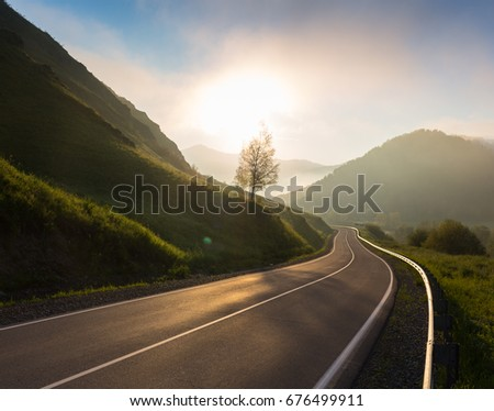 Road in sunrise time, Ailai mountains, Russia #676499911