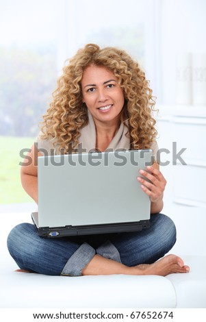 Woman at home using laptop computer Royalty-Free Stock Photo #67652674