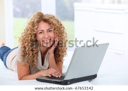 Woman at home using laptop computer Royalty-Free Stock Photo #67653142