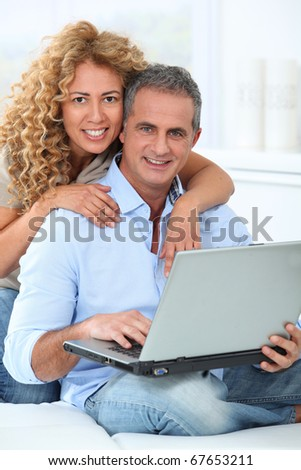 Couple surfing on internet at home #67653211