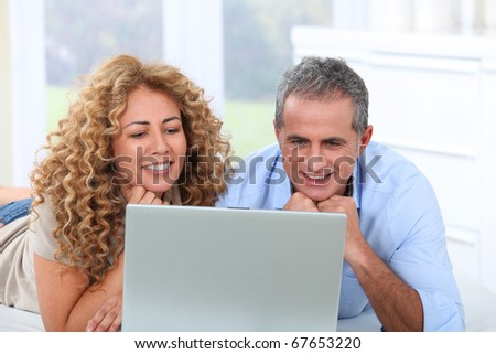 Couple surfing on internet at home #67653220