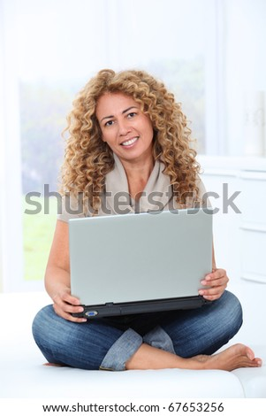 Woman at home using laptop computer Royalty-Free Stock Photo #67653256