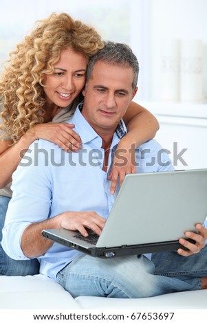 Couple surfing on internet at home Royalty-Free Stock Photo #67653697
