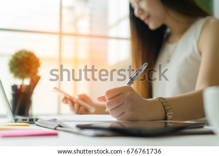 A business woman working on the laptop at the office #676761736