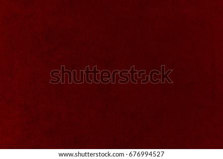 The texture of the  burgundy velvet. The background of burgundy cloth. Background of  burgundy velvet. #676994527