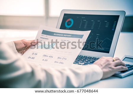 Business women reviewing data in financial charts and graphs #677048644