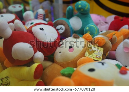 PENANG, MALAYSIA - JULY 13, 2017 : A street claw crane game machine in game center. Claw crane game machines are a frequent sight in japanese cities. #677090128