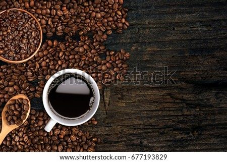 Coffee background, top view with copy space. White cup of coffee, ground coffee, coffee beans on dark wooden background #677193829