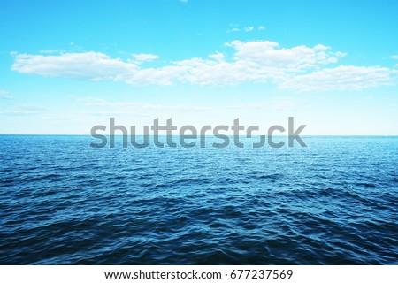 Calm Sea Ocean And Blue Sky Background. #677237569