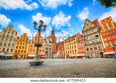 WROCLAW, POLAND - JULY 13, 2017: Wroclaw Old Town. City with one of the most colorful market squares in Europe. Historical capital of Lower Silesia, Poland, Europe. #677309413