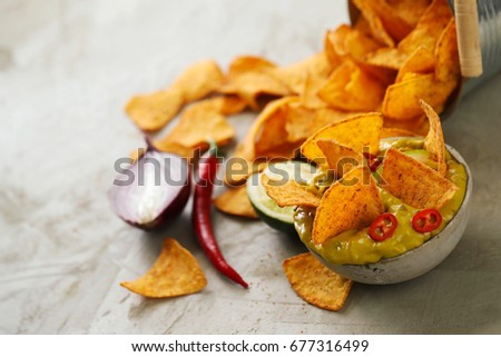 Snacks. Nachos with guacamole sauce #677316499