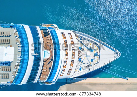 Nose of the cruise ship near the pier Royalty-Free Stock Photo #677334748