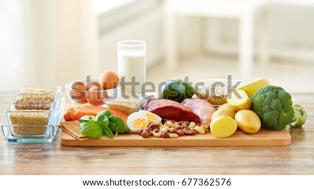 healthy eating and diet concept - natural food on table #677362576