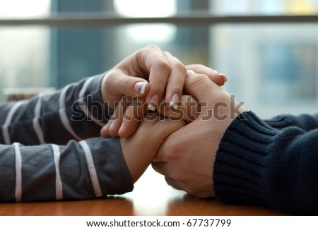 Man and woman holding each other hands #67737799