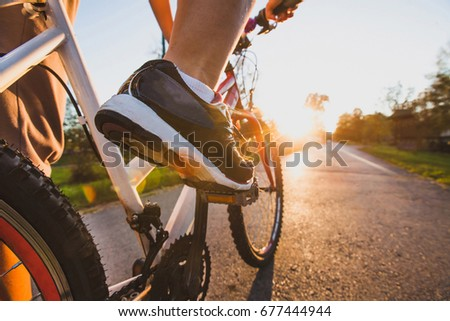 cycling outdoors, close up of the feet on pedal #677444944