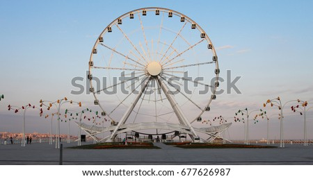 Ferris wheel in front of sky. Big carousel in Baku Royalty-Free Stock Photo #677626987