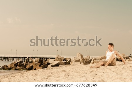 Happiness summer vacation and people concept. Fashion portrait handsome man full length on the beach landscape #677628349