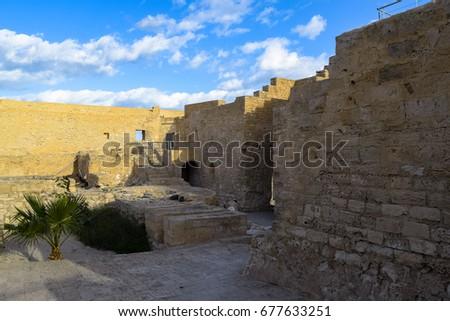 Medieval fortress Bordj El Kebir (Fort Ghazi Mustapha) at Mediterranean coast of Tunisia near Houmt El Souk town. Djerba island. North Africa #677633251