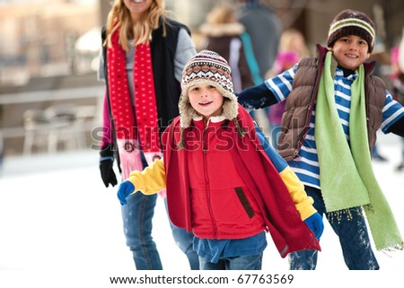 a family spends the day ice-skating outdoors