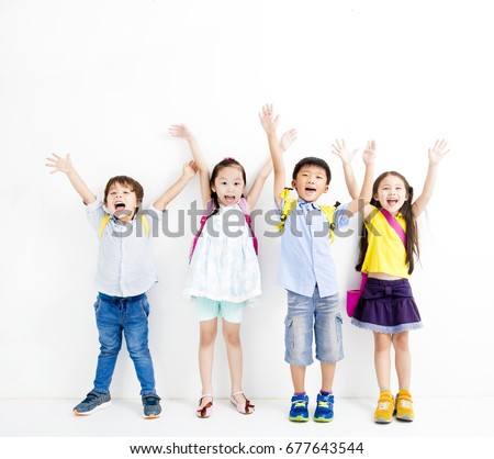 Group of happy smiling kids raise hands #677643544