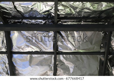 Ceiling Insulation under Framework of a House #677668417