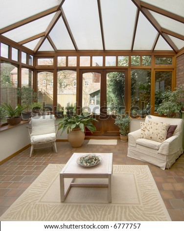conservatory tables chairs plants room in house next to garden #6777757